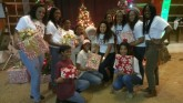 The Huston-Tillotson Cheerleaders take a break while volunteering to get their picture with Santa Clause!